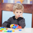 Unhappy Boy With Blocks In Classroom — Stock Photo