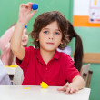 Boy Showing Clay In Classroom — Stock Photo