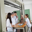 Teacher Experimenting While Students Looking At Him — Stock Photo