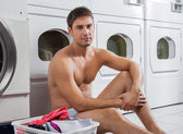 Semi Nude Man With Laundry Basket — Stock Photo