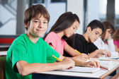 Teenage Boy With Friends Studying At Desk — Stock Photo