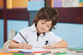 Boy With Sketch Pen Drawing In Kindergarten — Stockfoto