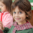 Little Boy Smiling With Classmate In Background — Stock Photo #28576323