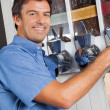 Male Customer Standing By Coffee Vending Machine — Stock Photo