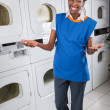 Stock Photo: Happy Female Helper Gesturing In Laundry