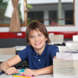 Schoolboy With Books And Globe At Desk — Stock Photo