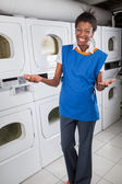 Happy Female Helper Gesturing In Laundry — Stock Photo