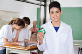 Schoolboy Holding Molecular Structure — Stock Photo