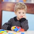 Boy With Blocks Looking Away In Preschool — Stock Photo