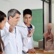 Teacher With Teenage Students Experimenting In Lab — Stock Photo