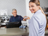 Female Customer Making Payment Through Credit Card In Store — Stock Photo