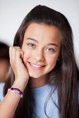 Beautiful Teenage Schoolgirl In Smiling Classroom — Stock Photo