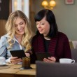 Female Friends With Digital Tablets At Coffeeshop — Stock Photo