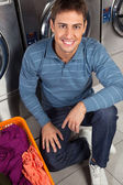 Man With Basket Of Clothes At Laundry — Stock Photo