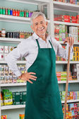 Senior Male Owner Standing Against Shelves In Store — Stock Photo