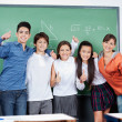 Stock Photo: Teenage Students Gesturing Thumbs Up Together