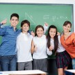 Teenage Students Gesturing Thumbs Up Together — Stock Photo