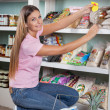 Beautiful Woman Choosing Food From Shelf — Stock Photo