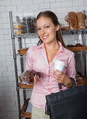 Woman Holding Cake And Coffee Cup At Store — Stock Photo