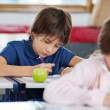 Schoolboy Drawing In Classroom — Stock Photo