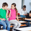 Teenage Boy And Girl Listening Music In Classroom — Stock Photo