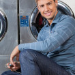 MListening To Music At Laundromat — Stock Photo #29135571