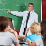 Teacher Teaching Geometry To Schoolchildren — Stock Photo