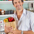 Man With Grocery Bag In Supermarket — Stock Photo