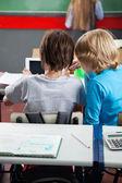 Schoolboys Using Digital Tablet At Desk — Stock Photo
