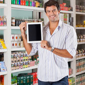 Man Showing Tablet In Supermarket — Stock Photo