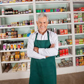Store Owner Smiling In Supermarket — Stock Photo