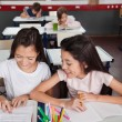 Schoolgirls Studying Together In Classroom — Stock Photo