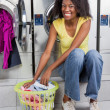 Woman With Basket Of Clothes In Laundry — Stock Photo