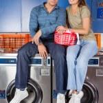Couple Sitting On Washing Machines — Stock Photo