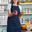 Saleswoman Holding Apples In Supermarket — Stock Photo