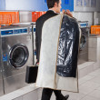 Businessman With Suitcase And Suitcover Walking In Laundry — Stock Photo #29338719