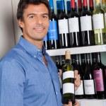 Portrait Of Man Showing Alcohol Bottle — Stock Photo #29339257