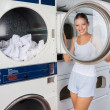 Stock Photo: WomLooking Through Washing Machine Lid