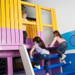 Girls Climbing Playhouse Ladder While Boy Looking At Them — Stock Photo