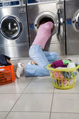 Woman Searching Clothes In Washing Machine Drum — Stock Photo