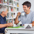 Father And Son Communicating While Having Coffee — Stock Photo #29340143