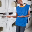 Female Helper Gesturing In Laundry — Stock Photo