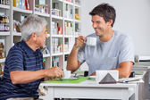 Father And Son Communicating While Having Coffee — Stock Photo