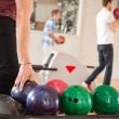 Stock Photo: MPicking Bowling Ball With Friends in Background