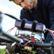 Stock Photo: TechniciFixing CamerOn UAV Drone