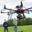 Stock Photo: Technicians Flying UAV Spy Drone