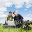 Technicians Working On Laptop By UAV in Park — Stock Photo