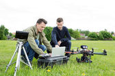 Technicians Using Laptop By Tripod And UAV — Photo