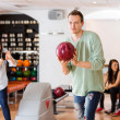 Man Bowling With Friend Photographing in Club — Stock Photo