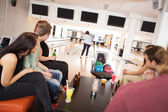 Friends Watching Woman Bowling in Alley — Stock Photo
